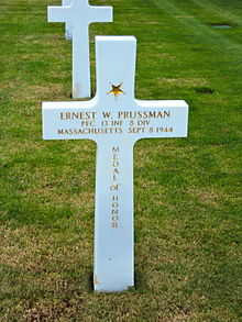 The gravestone of Ernest W Prussman, recipient of the Medal of Honor, Saint James Cemetery Normandy.