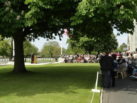 Veterans, relatives, representatives of the regiments who fought on D-Day, and a broad range of well-wishers, sightseers and dignitaries congregate under the spreading chestnut trees for a Memorial Day service, 26 May 2013.