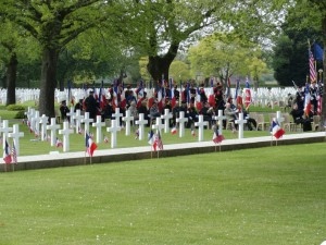 U.S. Cemetery St James, Normandy. The veterans sit quietly under the trees, remembering fallen comrades so long ago. Every year, the number of veterans gets smaller.